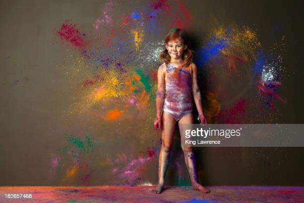 Caucasian girl playing with paint