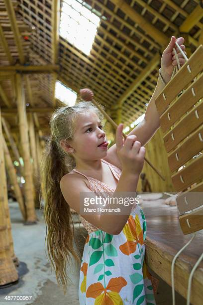 caucasian girl playing with xylophone in workshop - bamboo instrument stock photos and pictures