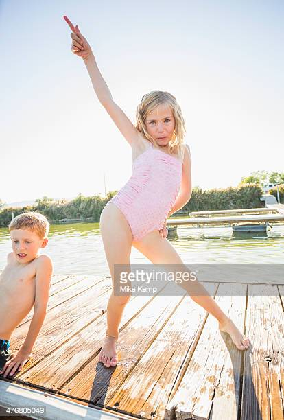 caucasian girl posing on dock - human limb stock pictures, royalty-free photos & images