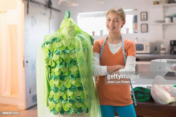 Caucasian girl posing with green costume