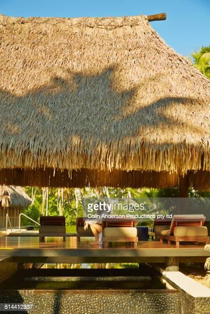 Caucasian girl relaxing in hut