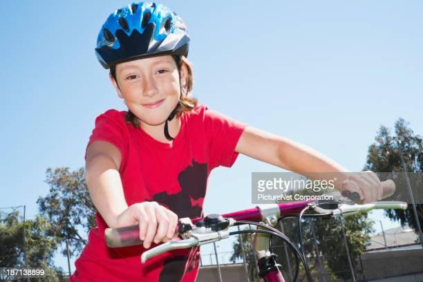 Caucasian girl riding bicycle outdoors