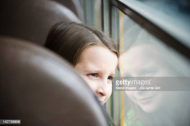 caucasian girl riding school bus - montclair stock pictures, royalty-free photos & images