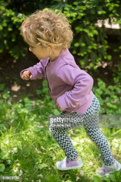 Caucasian girl running outdoors
