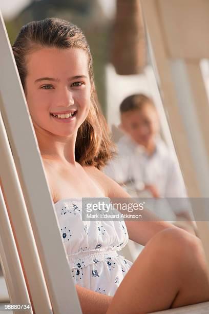 Caucasian girl sitting in chair