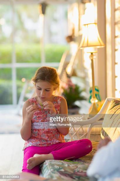Caucasian girl sitting on patio