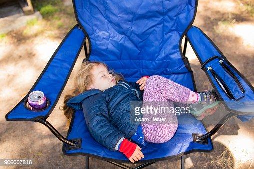 Caucasian girl sleeping on folding chair