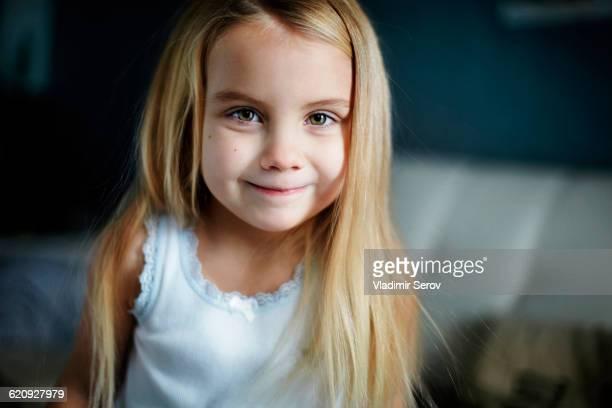 Caucasian girl smiling indoors