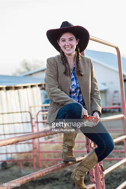 caucasian girl smiling on farm - cowgirl hairstyles stock photos and pictures