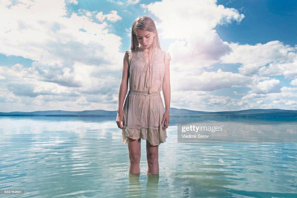 Caucasian girl standing in lake : Foto stock