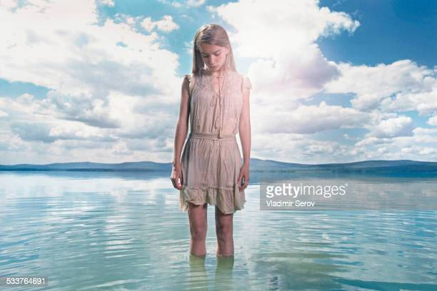 caucasian girl standing in lake - tween girls hot stock photos and pictures