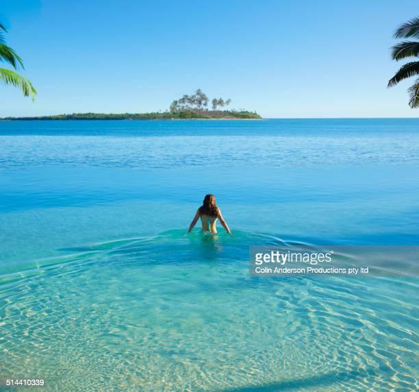 Caucasian girl standing in tropical ocean