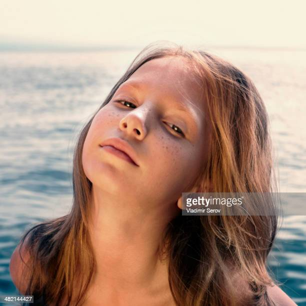 caucasian girl standing on beach - tween girls hot stock photos and pictures