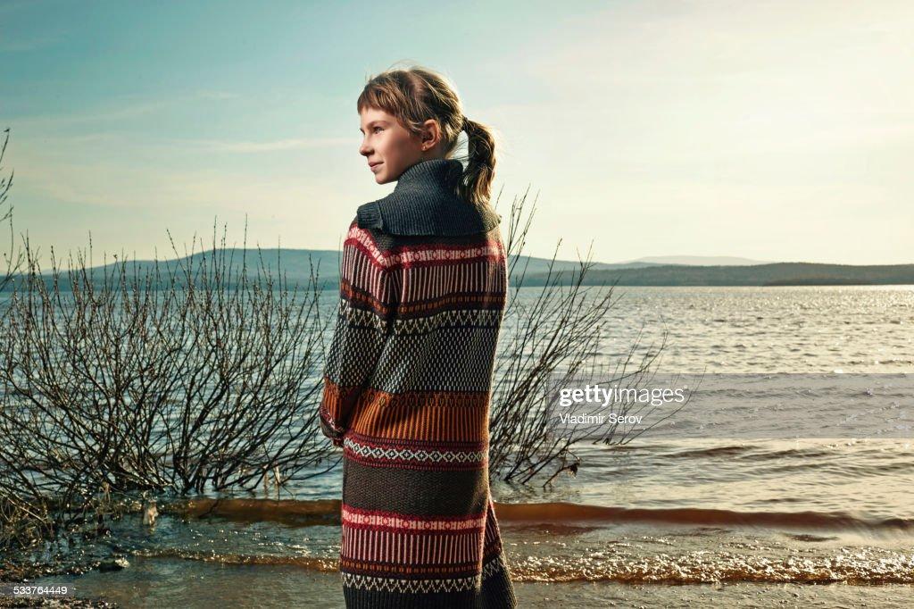 Caucasian girl standing on beach : Foto stock