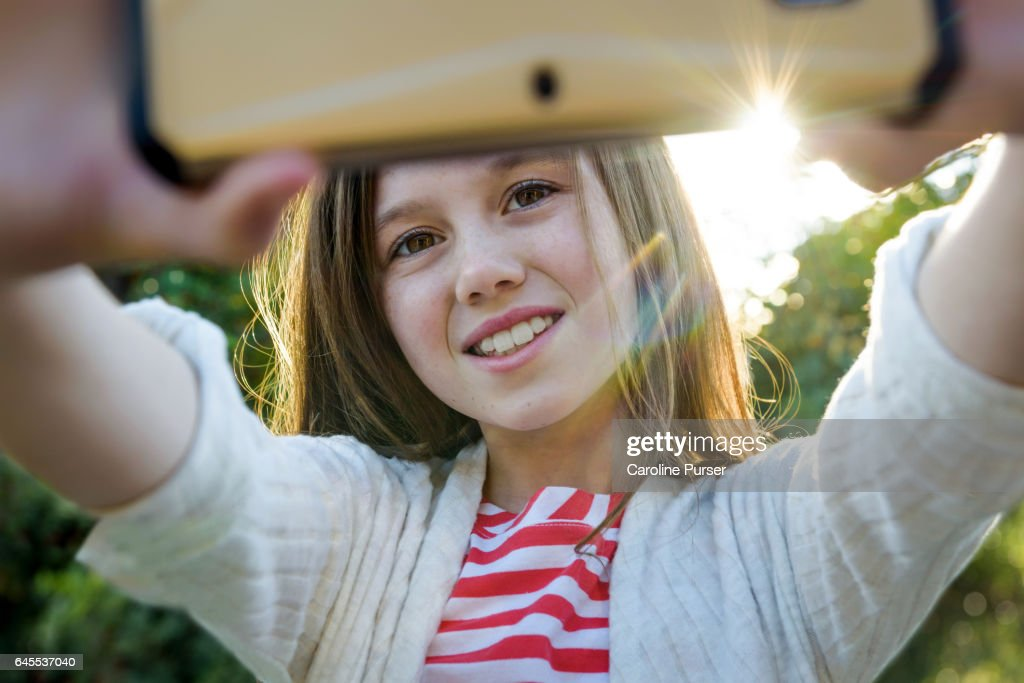 Caucasian girl (9-13) taking selfie : Stock Photo