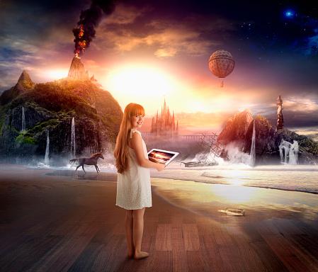 Caucasian girl using digital tablet in dramatic landscape - gettyimageskorea