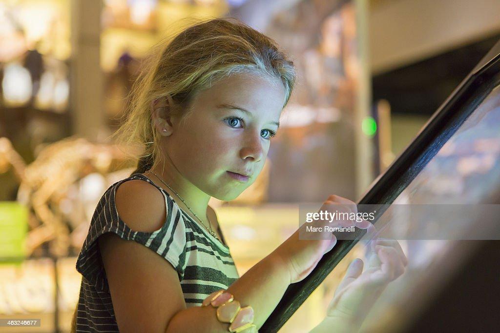 Caucasian girl using touch screen : Stock-Foto