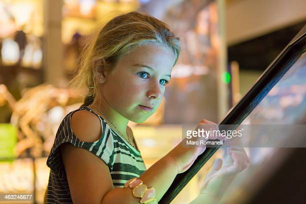 caucasian girl using touch screen - museo fotografías e imágenes de stock