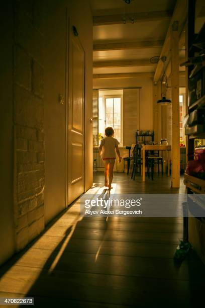 caucasian girl walking in kitchen - corridor stock pictures, royalty-free photos & images