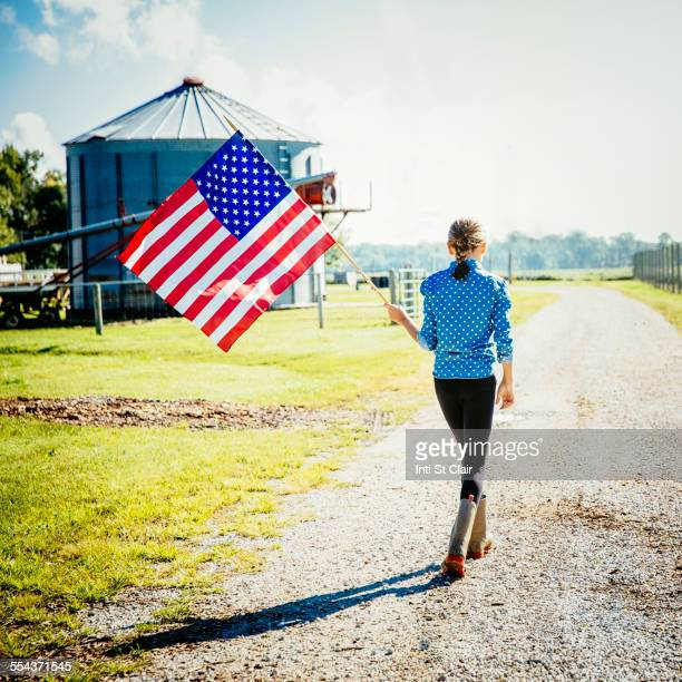 caucasian girl waving american flag on farm - nebraska stock pictures, royalty-free photos & images