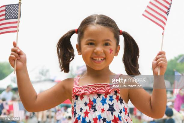 caucasian girl waving american flags - independence day stock pictures, royalty-free photos & images