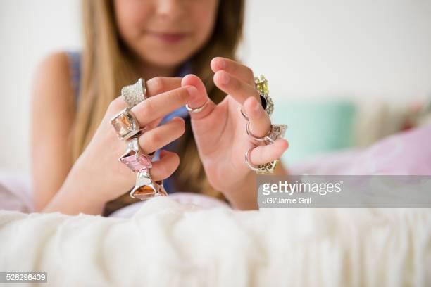 Caucasian girl wearing costume rings