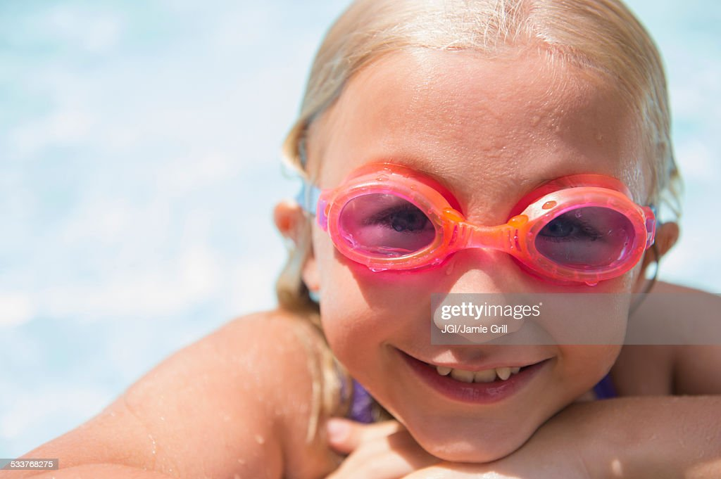 Caucasian girl wearing goggles in swimming pool : Foto stock