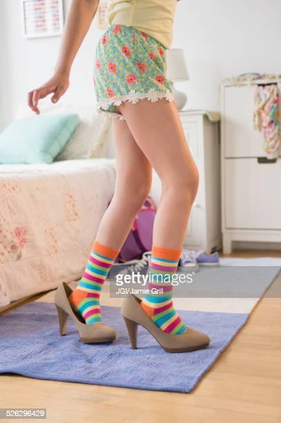caucasian girl wearing high heels in bedroom - little girl in high heels stock photos and pictures