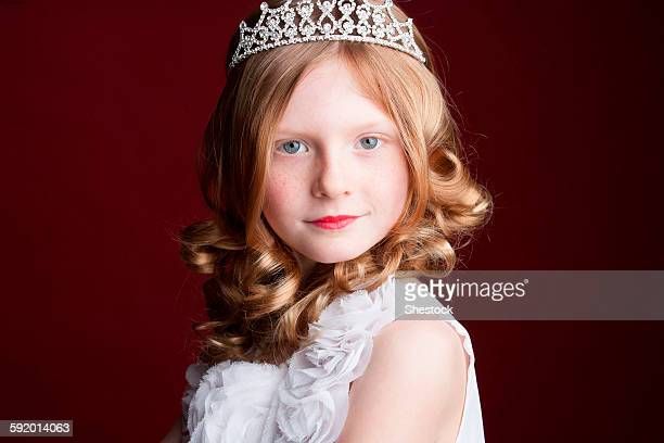 Caucasian girl wearing tiara and princess costume