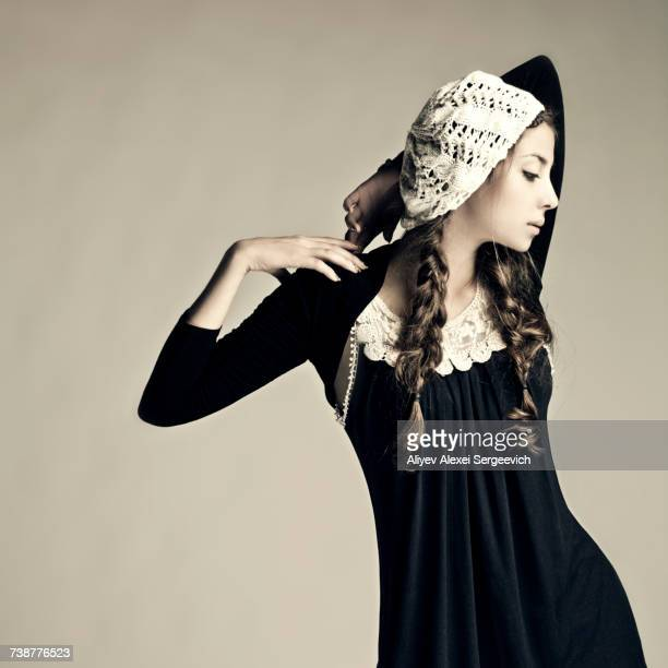 caucasian girl wearing traditional dress and hat - pilgrims stock photos and pictures