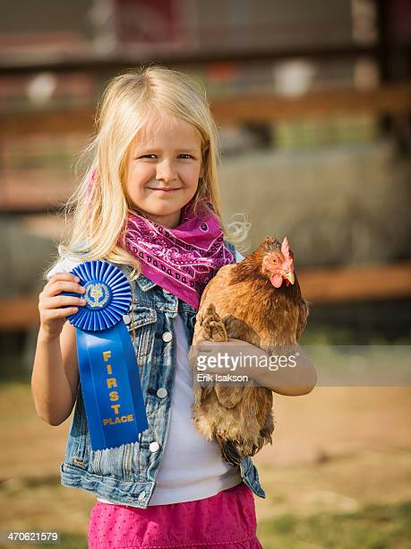caucasian girl with prize winning chicken on farm - livestock show stock pictures, royalty-free photos & images