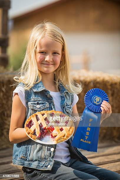caucasian girl with prize winning pie on farm - contestant stock pictures, royalty-free photos & images
