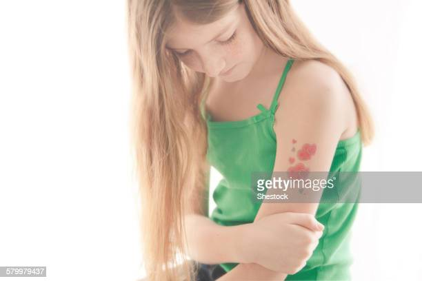 caucasian girl with temporary tattoo on arm - temporary stock pictures, royalty-free photos & images