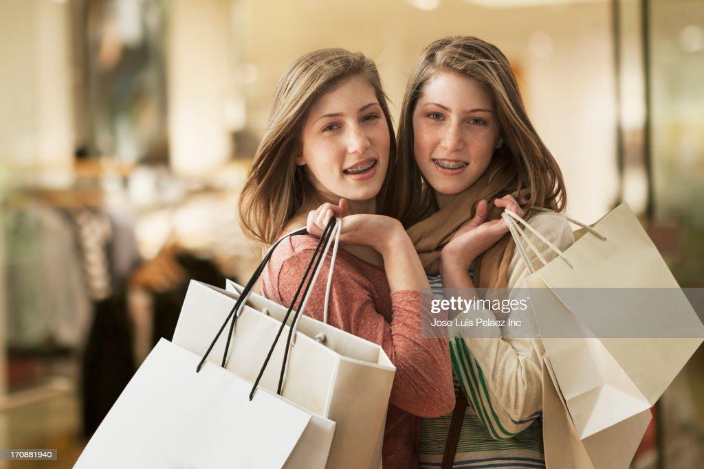 Caucasian girls carrying shopping bags : Stock Photo
