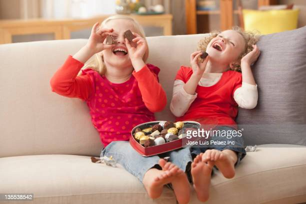 caucasian girls eating valentine's candy - naughty valentine stockfoto's en -beelden