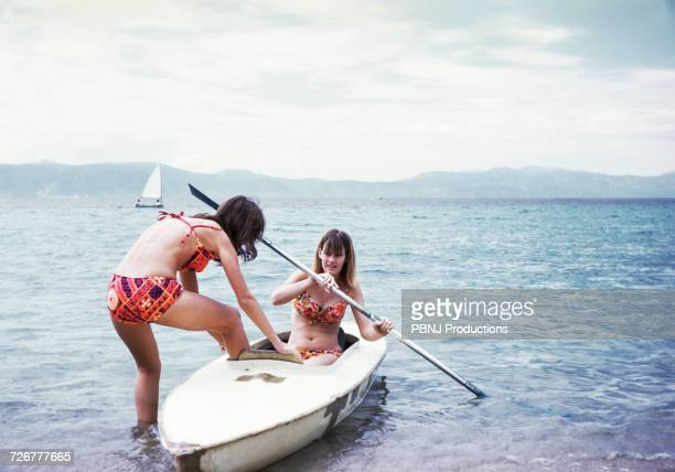 caucasian girls in kayak on lake - filmato d'archivio foto e immagini stock