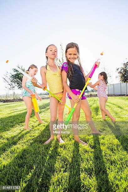 Caucasian girls playing in backyard
