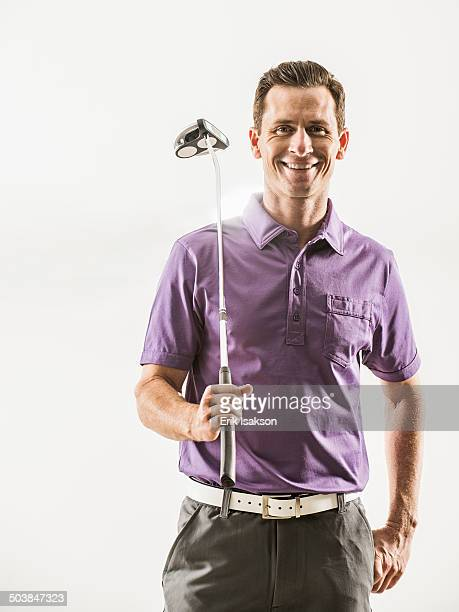 Caucasian golf player smiling