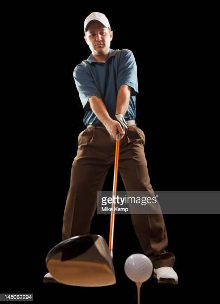 caucasian golfer about to hit golf ball - ショットを決める ストックフォトと画像