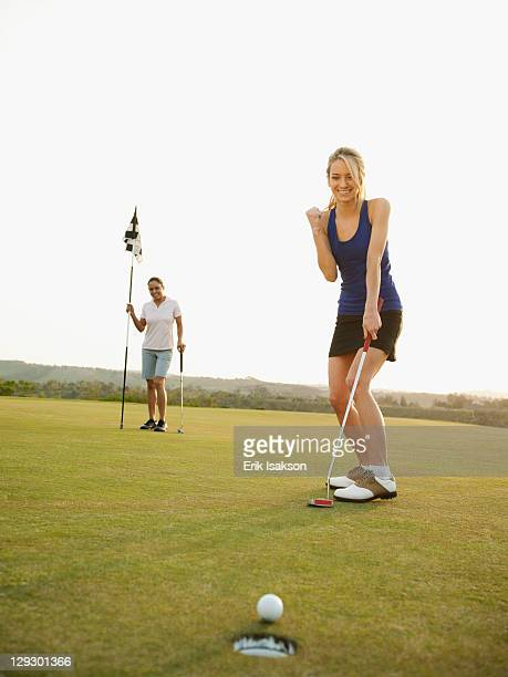 Caucasian golfer cheering on golf course
