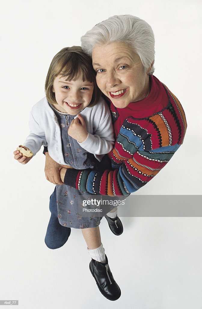 caucasian grandma holds giggling granddaughter : Foto de stock