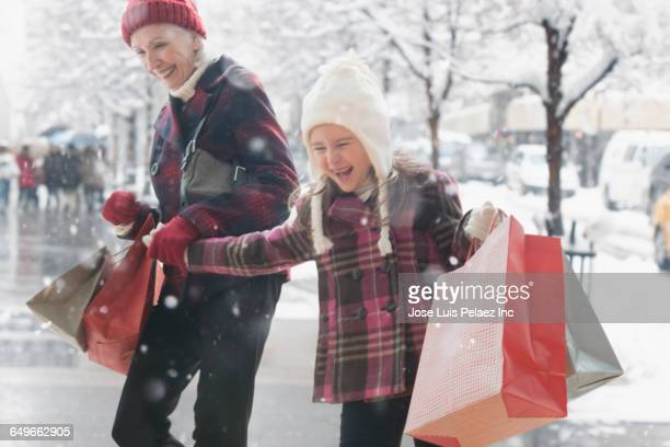 Caucasian grandmother and granddaughter shopping for Christmas gifts