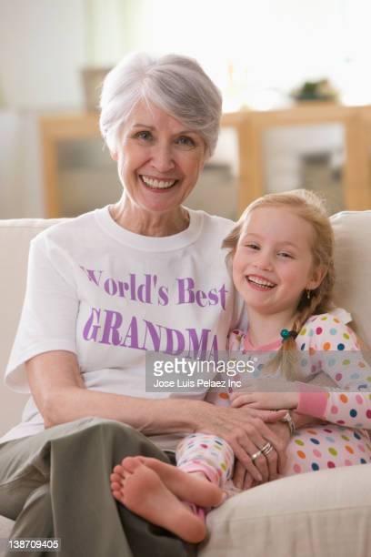 caucasian grandmother and granddaughter sitting on sofa together - west new york new jersey - fotografias e filmes do acervo