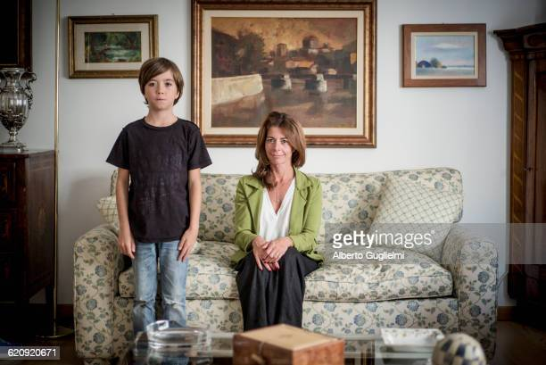 Caucasian grandmother and grandson in living room