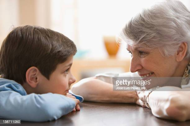 caucasian grandmother and grandson smiling at each other - west new york new jersey - fotografias e filmes do acervo