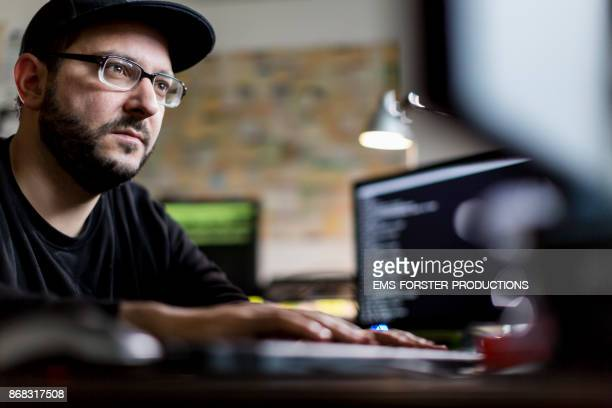 caucasian hacker stealing information from computer
