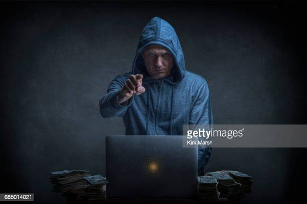 caucasian hacker stealing money from laptop - identity theft stock pictures, royalty-free photos & images
