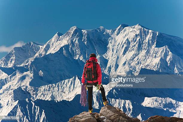 caucasian hiker admiring scenic view from mountaintop, monte rosa, alps, italy - 尾根 ストックフォトと画像