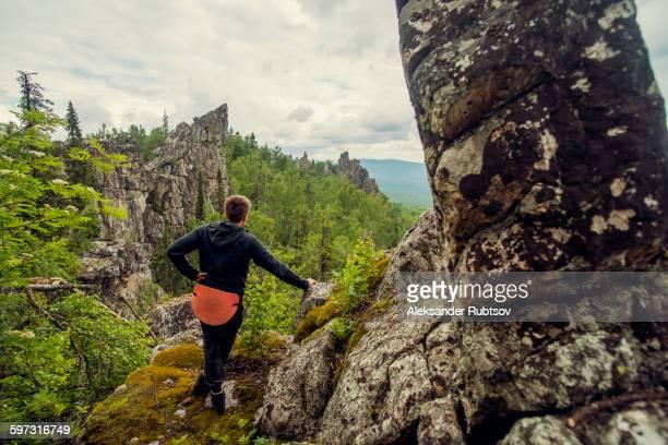 Caucasian hiker admiring view from hilltop