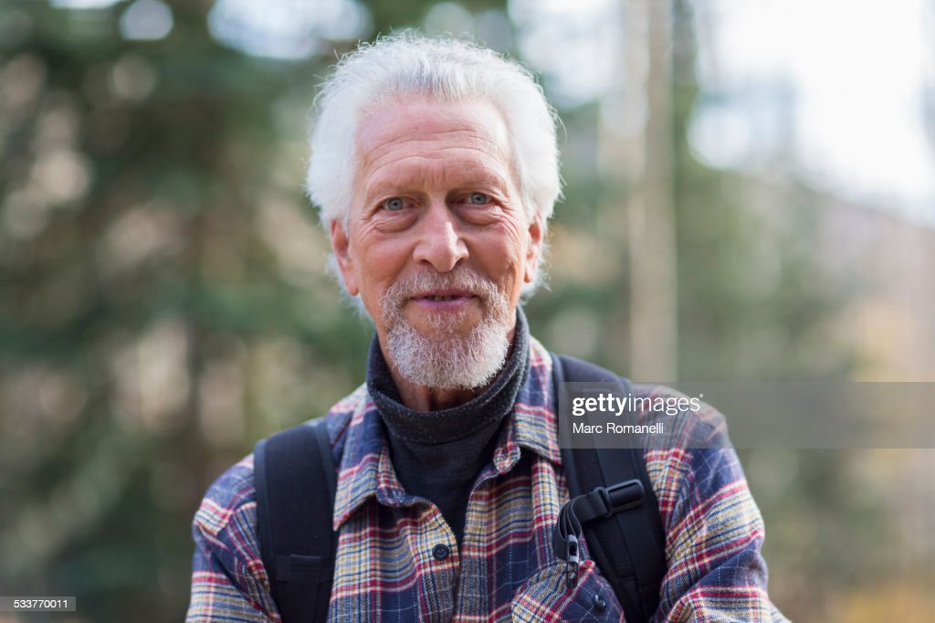 Caucasian hiker smiling in forest : Foto stock